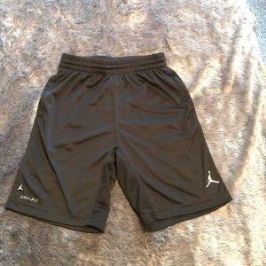 Youth Dri-Fit black basketball shorts with pockets